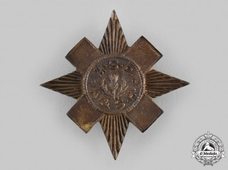 Canada, Commonwealth. An Argyle and Sutherland Highlanders Military School of Pipers Cap Badge, c.1940