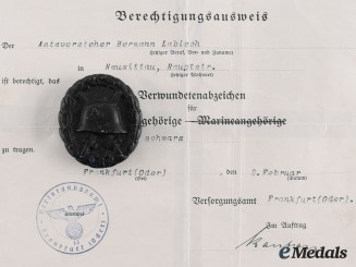 Germany, Third Reich. A Wound Badge and Document to Hermann Labisch