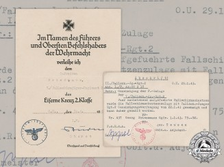 Germany, Luftwaffe. An Iron Cross II Class Document & Bonus Salary Certificate, Fallschirmjäger