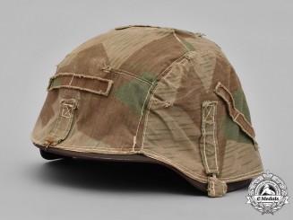 Germany, Heer. A Heer M40 Steel Helmet with Camouflage Cover
