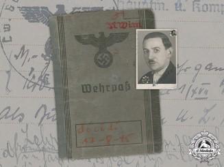 Germany, Luftwaffe. A Wehrpaß to Karl Wimmer (Honour Badge in Silver, Einsatzstaffel der D.M. in Croatia)