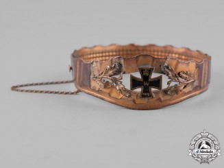 Germany, Imperial. A Trench Art Bracelet with Oak Leaves and Miniature Iron Cross