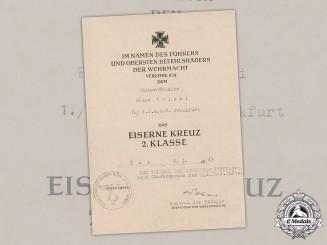 Germany, Luftwaffe. An Iron Cross, II Class, Award Document to Unteroffizier Heinz Wolski, 1943