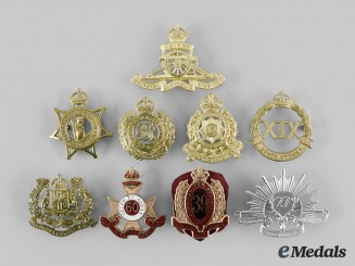 Australia. A Lot of Nine Cap Badges