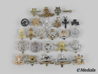 United Kingdom. A Lot of Twenty-Six Second War Era Regimental Cap Badges