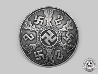 A Decorative Runic Brooch in Silver