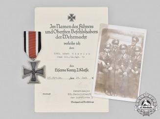 Germany, Luftwaffe. An Iron Cross Second Class and Award Document to  Unteroffizier Ernst Ulbrich