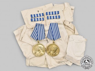 Yugoslavia, Socialist Republic. WWII Bravery Medal, Lot of 12 Medals, Mint and in Pocket of Issue