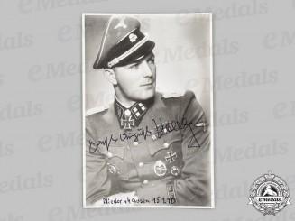 Germany, SS. A Postwar Signed Photo of SS-Sturmbannführer Ernst-August Krag, Knight's Cross with Oak Leaves