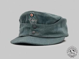 Germany, Ordnungspolizei. A Schutzpolizei EM/NCO's M43 Cap, by Bayerische Mützen-Fabrik