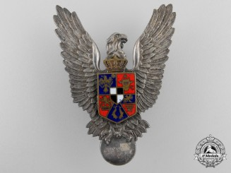 A Scarce Second War Romanian Pilot's Badge in Solid Silver