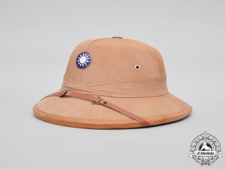 China. A Second War Period Pith Helmet by Tsung & Co. Helmet Manufacturing