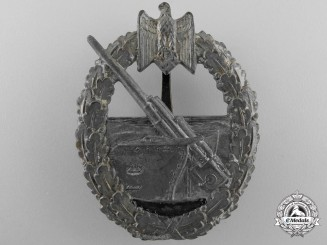 A Kriegsmarine Coastal Artillery Badge by Juncker