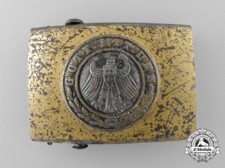 A Weimar Republic Army (Reichsheer) Belt Buckle worn with Civilian Clothes