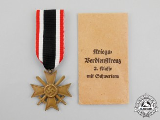 A Mint War Merit Cross Second Class with Swords in its Packet of Issue by Türk's Widdow