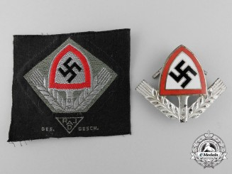 Two RAD Officer's Cap Badges