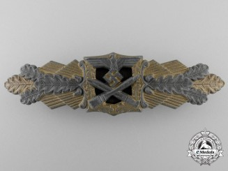 An Unusual Bronze Grade Close Combat Clasp by Friedrich Linden, Lüdenscheid