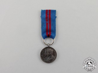 A Miniature British King George V and Queen Mary Coronation Medal 1911