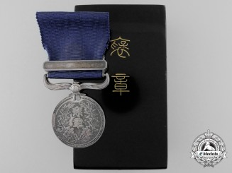 A Japanese Merit Medal with Case; Named to Recipient