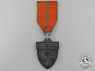 A 1938 NSKK, Dutch, & Belgian International Sports Medal; Named