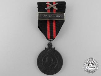 A Finnish Winter War 1939-1940 Medal with ILMAPUOLUSTUS Clasp