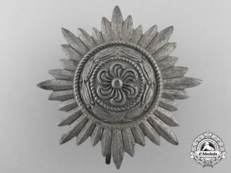A Silver Grade Ostvolk Decoration; First Class