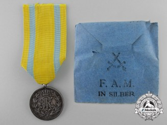 A Saxon Friedrich August Medal; Silver Grade with Packet