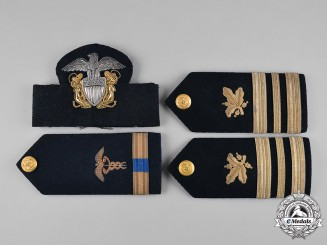 United States. A Navy Cap Badge and three Shoulder Boards