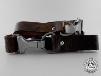 A Brown Leather Shoulder Strap by F.W. Assmann & Söhne,Lüdenscheid