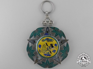 A Chinese (Republic 1928-1949) Police Merit Decoration; Second Class Grade I with Three Stars