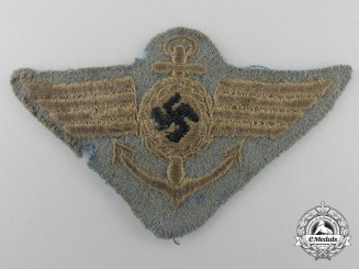 A Very Rare SA-Marine Side Cap Badge