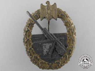 A Kriegsmarine Coastal Artillery Badge by Funcke & Brüninghaus