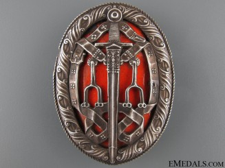 The Knight's Bachelor's Badge (KB)