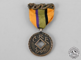 China, Imperial. An Order of the Imperial Dragon, Society Medal for the China Relief Expedition to Charles H. Swartz, c.1880