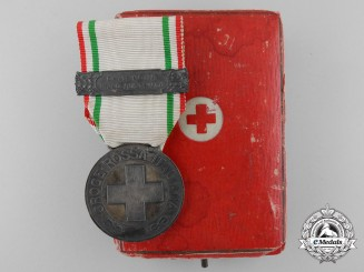 An Italian Benemerenti Red Cross Medal with Clasp & Case