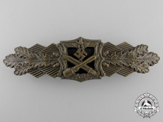 A Mint Bronze Grade Close Combat Clasp by maker A.G.M.u.K.
