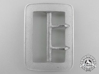 A Custom Official's Two-Prong Open-Claw Belt Buckle by F.W. Assmann; Published
