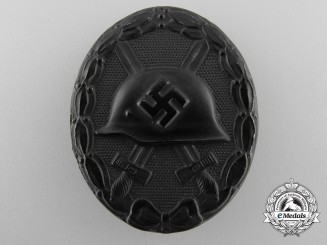 A Mint Black Grade Wound Badge