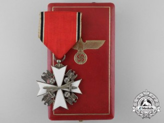 A Cased German Eagle Order; Third/Fifth Class Cross with Swords