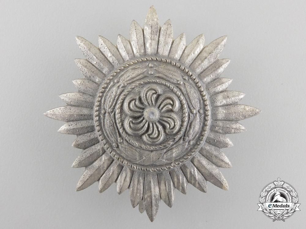 An Ostvolk Decoration First Class; Silver Grade