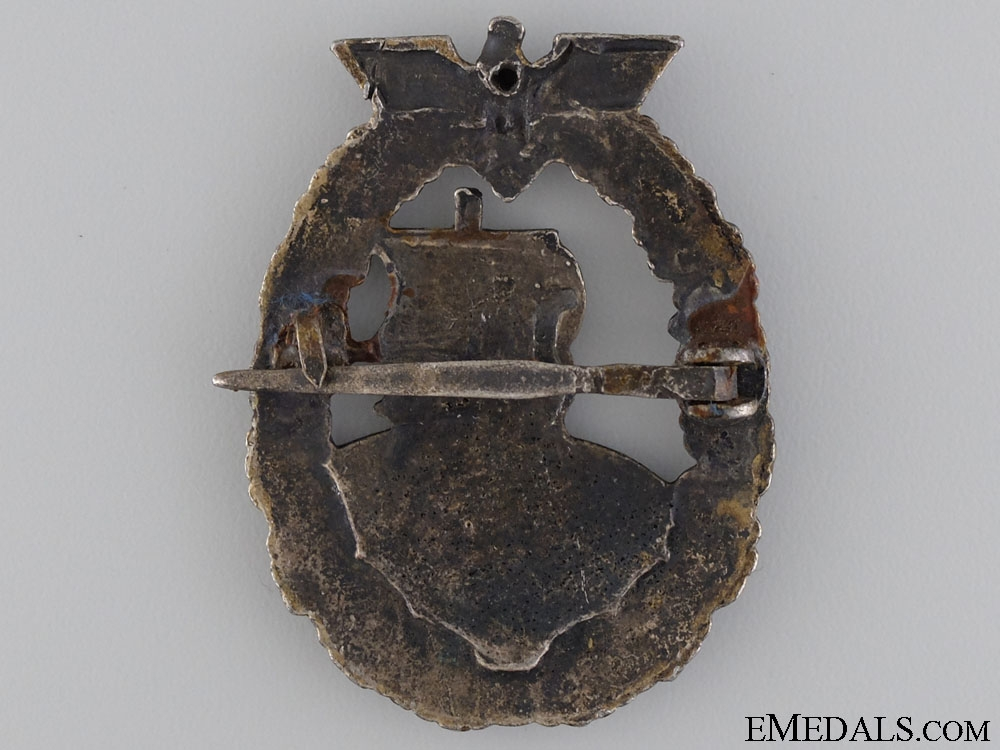 A Kriegsmarine Auxiliary Cruiser War Badge by French Maker Bacqueville, Paris