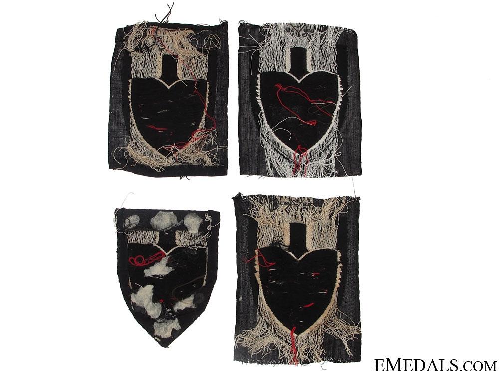 Four RAD Cloth Insignia