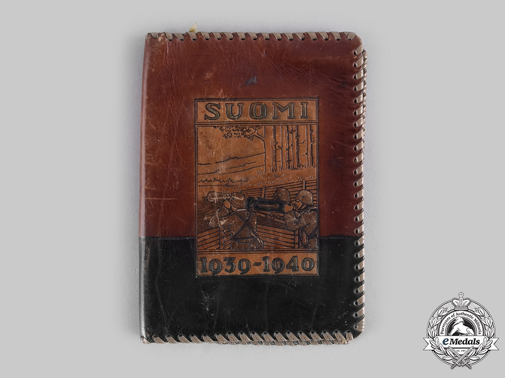 Finland. A Second World War Medal Bar and Decorative Leather Wallet, c.1945