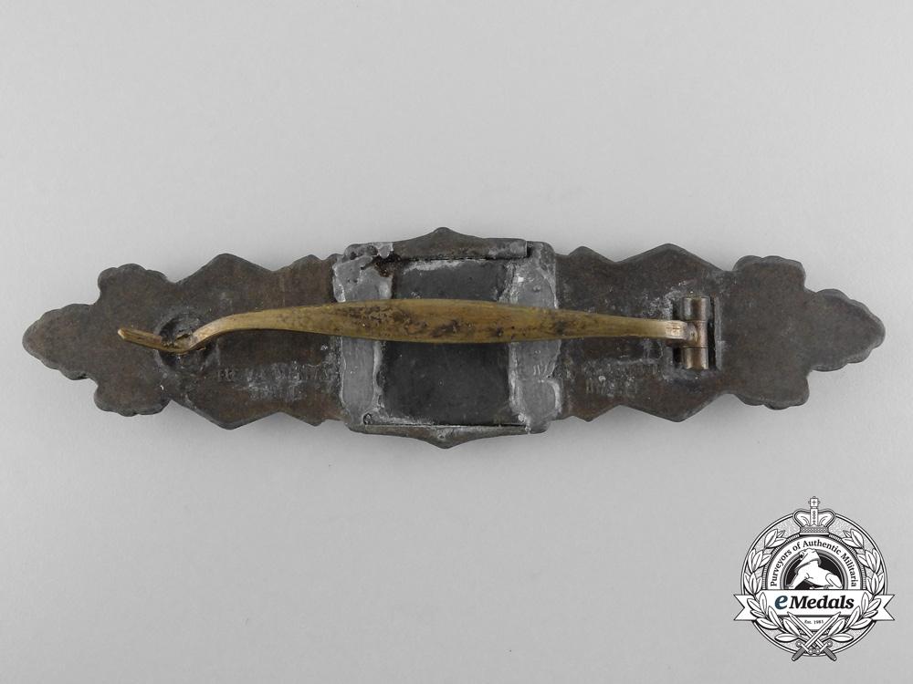 Germany, Heer. A Close Combat Clasp, Bronze Grade, by C.E. Juncker; Field Repair