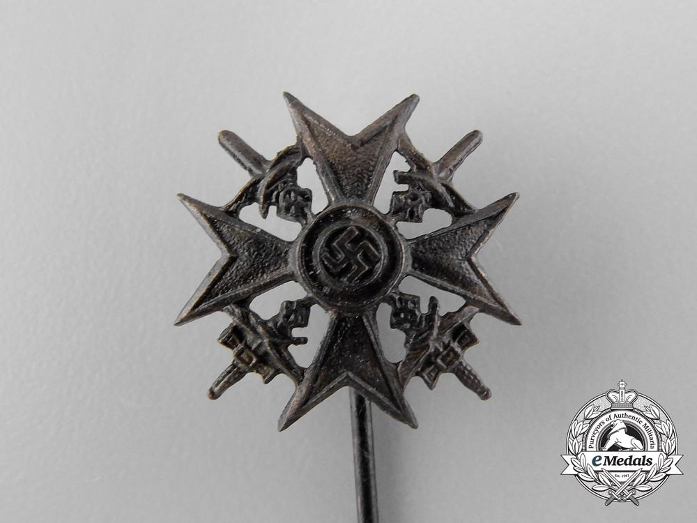 A  Miniature Stickpin Spanish Cross in Bronze