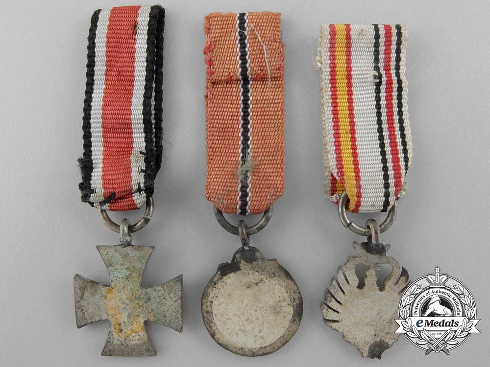 Three Spanish Made German Miniature Awards