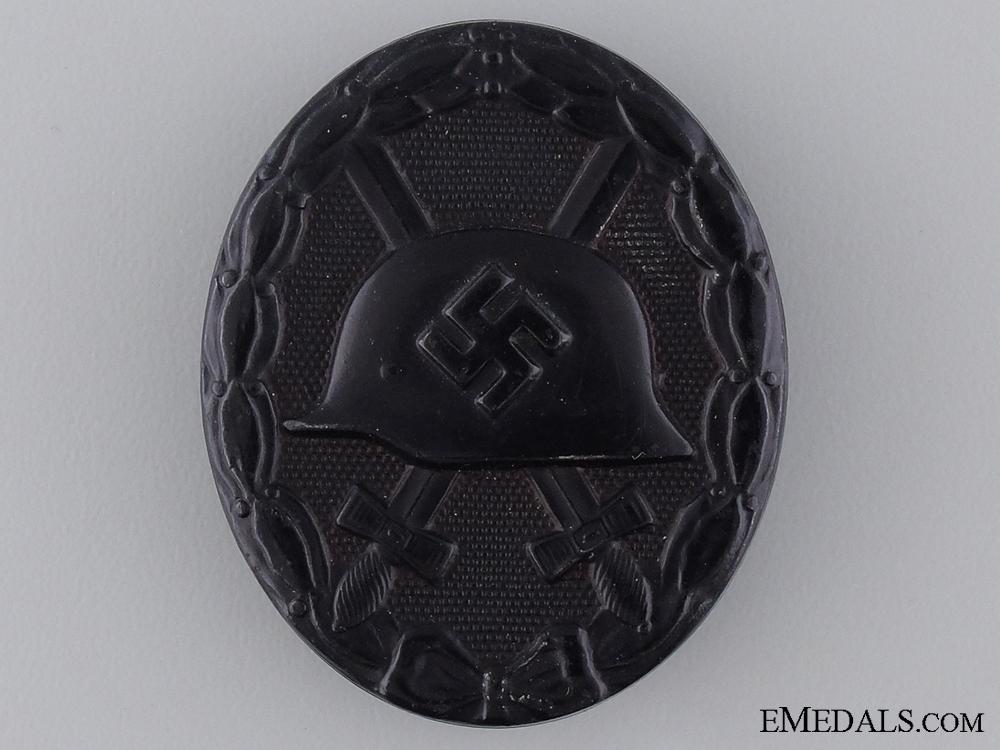 A Black Grade Second War Wound Badge; Marked