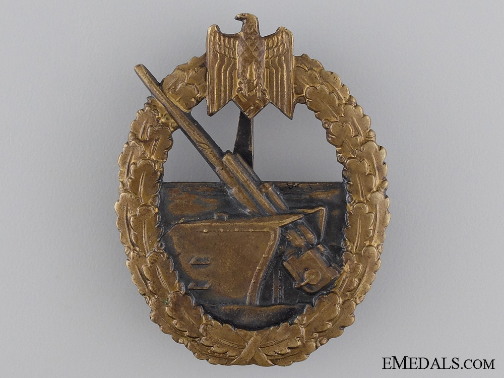 A Coastal Artillery badge by C.E. Juncker