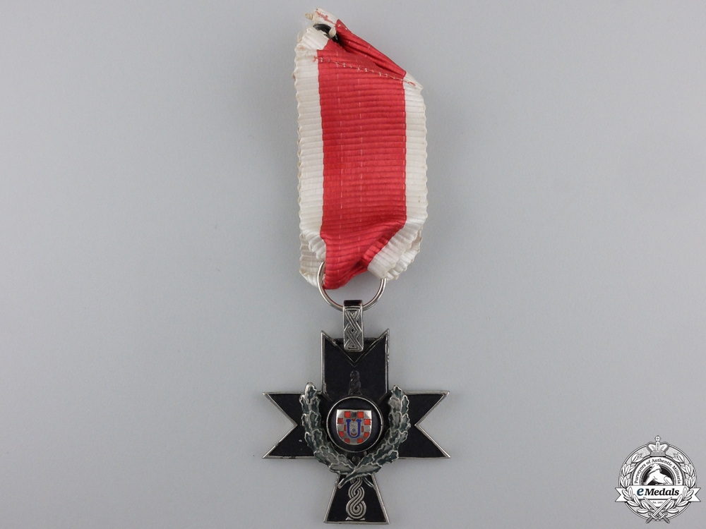 A Croatian Order of Iron Trefoil; Third Class with Oakleaves