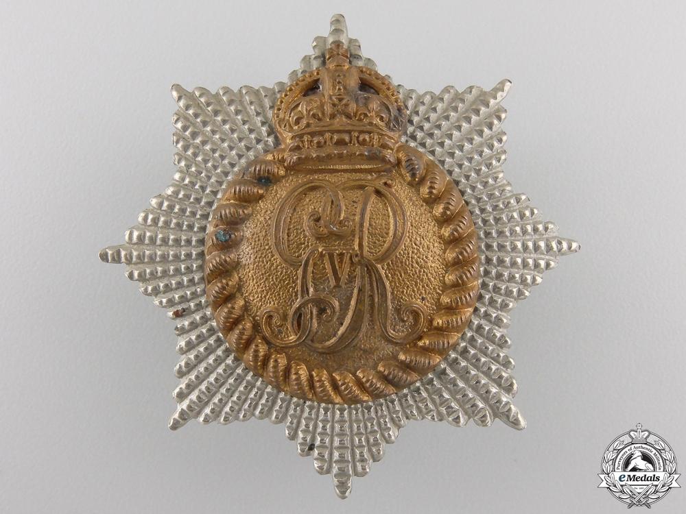A First War Royal Canadian Regiment Cap Badge